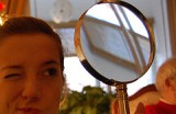 image-of-woman-with-magnifier-courtesy-of-magitisa.jpg