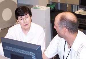 John L working with genealogy patron, photo courtesy of Jason Bowen