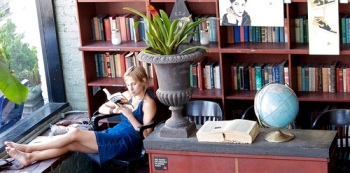 Image of a woman reading at Bauhause Coffee courtesy of Jennifer Conley via Flickr