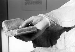 image of statue hand with book courtesy of opacity via flickr