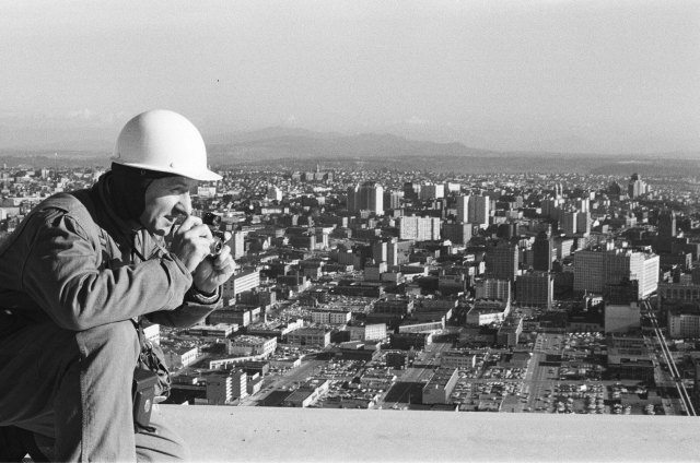 Photographer George Gulacsik atop the Space Needle, ca. November 1961