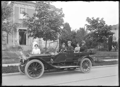 Piper's mother, Wilhemina, in the back of an automobile, ca. 1910