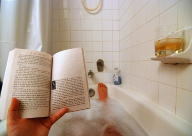 Image of man reading in bathtub courtesy Kevin Harber via Flickr